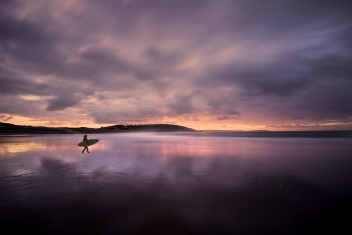 owenahincha beach sunrise surfer